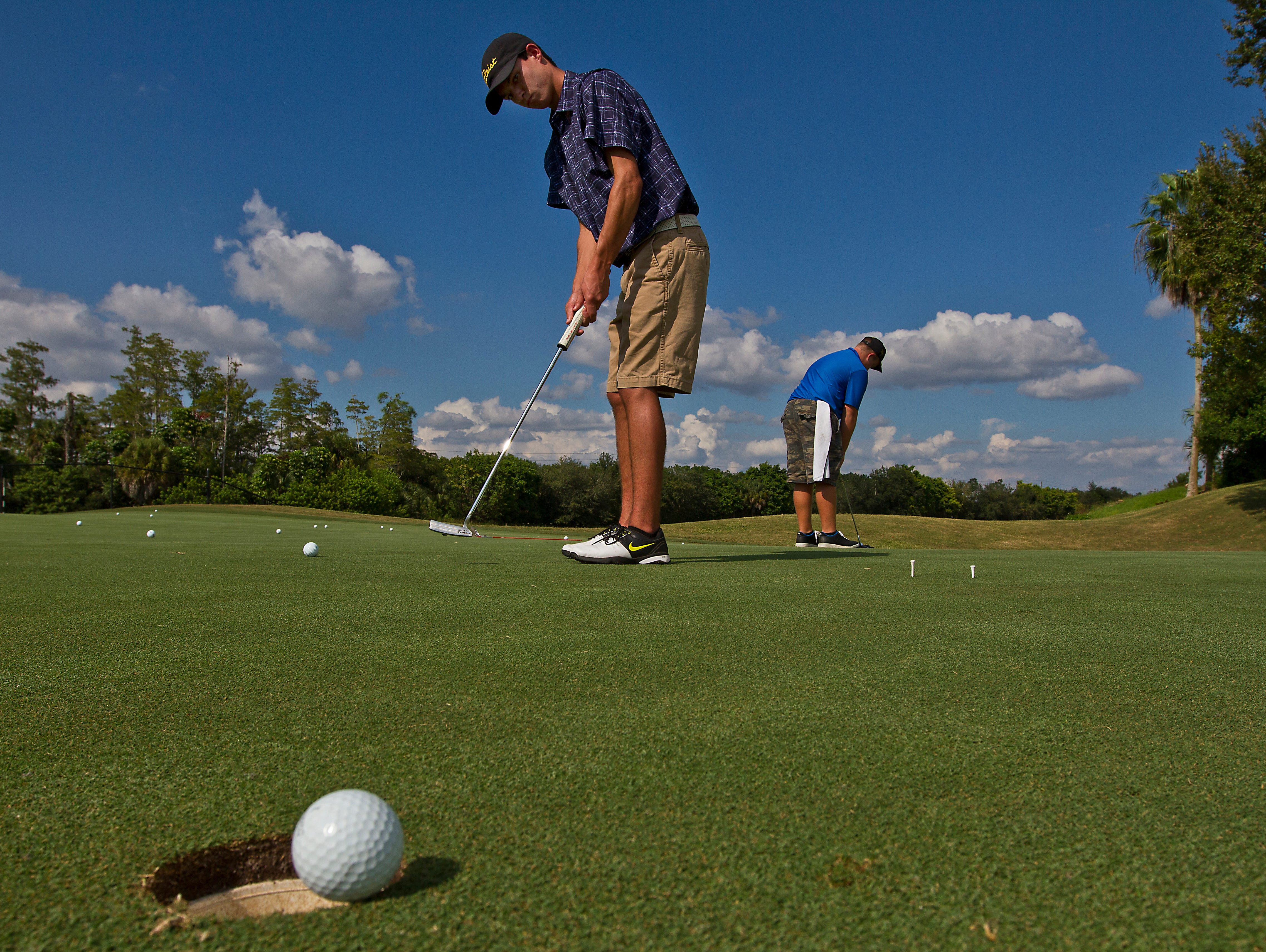 Bishop Verot High School freshman Blake Wheeler, 15, of Fort Myers, works on his putting game Thursday afternoon at Stoneybrook Golf Club during a team practice.
