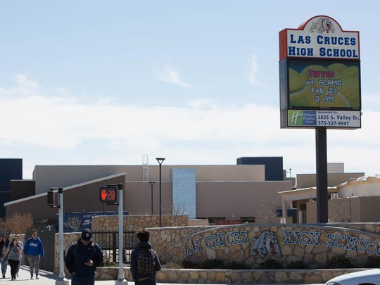 Students walk near Las Cruces High School on Friday, Feb. 23, 2018, following reported school shooting threats that turned out to be false, authorities said.