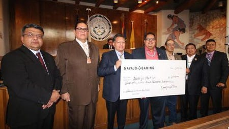 Officials with the Navajo Nation Gaming Enterprise presented a check for $1.5 million to the tribe on Jan. 25 during the Navajo Nation Council's winter session in Window Rock, Ariz. The money goes to the Navajo Gaming Net Revenue Distribution Fund, which provides chapters funds for infrastructure, housing, economic development and education.