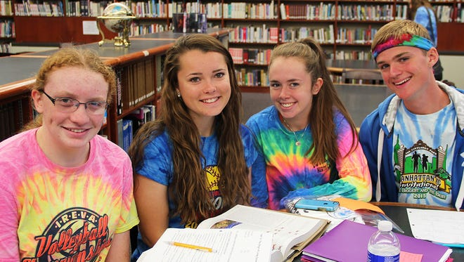 From left, seniors McGinnis Miller, 17 of Endwell; Alyssa Pochkar, 18, of Endicott; Samantha Connery, 17, of Endwell; and  Nick Taylor,  17, of Endicott, dress in tie-dye for Maine-Endwell school's spirit week. The week leads up to the school's Homecoming on Saturday.