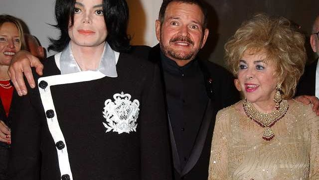 Dr. Arnold W. Klein, center, a dermatologist to celebrities including Michael Jackson, left, and Elizabeth Taylor, died Thursday in Rancho Mirage, officials report.