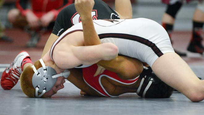 Jacob Lasanske of Menomonee Falls works to pin Johsn Reindl of Sussex Hamilton in the 126-pound championship match.