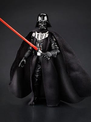 """This photo provided by Hasbro shows the Darth Vader toy from the """"Star Wars"""" films. Kids of all ages love toys."""