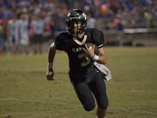 Senior quarterback Daniel Lotief runs the ball early