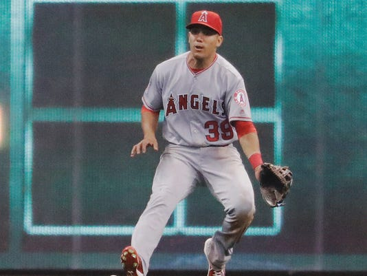 Los Angeles Angels' Rafael Ortega can't handle a ball hit by Milwaukee Brewers' Yadiel Rivera during the fifth inning of a baseball game Monday, May 2, 2016, in Milwaukee. (AP Photo/Morry Gash)