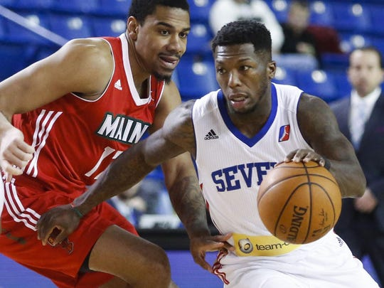 NBA veteran Nate Robinson (right) gets past the Red Claws' Arthur Edwards as during a Delaware 87ers game at the Bob Carpenter Center Tuesday.