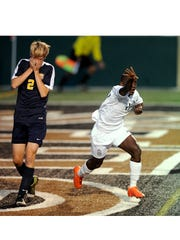 Abilene High's Rey Mouloungui (17) celebrates after