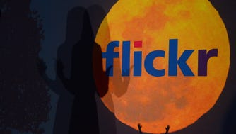 A logo for Flickr website, then owned by Yahoo, in 2013. In 2018, Smugmug said it had bought the photo sharing website for an undisclosed sum.