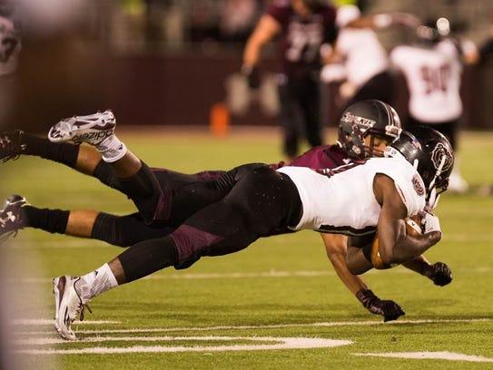 Missouri State's Eric Phillips makes a diving interception