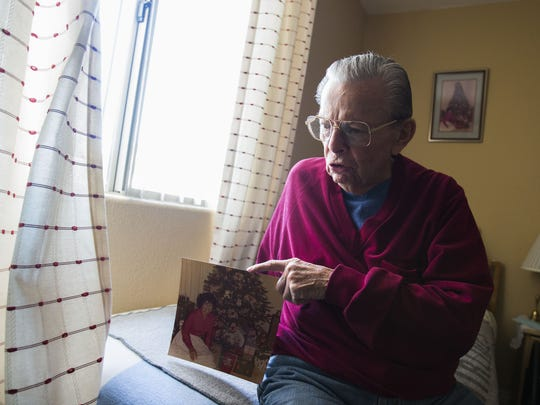 Jimmy Valentine tells stories of his late wife, Mary Ann. Her photo hangs above his bed.