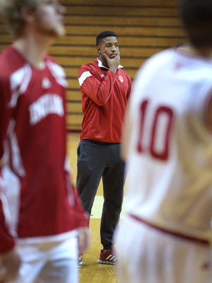 Hoosiers forward Devin Davis watches his teammates warm up before the start of their game, December 2, 2014.
