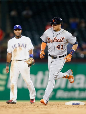 Tigers designated hitter Victor Martinez (41) rounds the bases after hitting a home run in the ninth inning of the Tigers' 10-4 loss to the Rangers on Tuesday, Aug. 15, 2017, in Arlington, Texas.