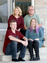 Clockwise from bottom left, Brandon, Lisa, Mark and Haley Vinson pose for a portrait outside the family's home in West Jordan on Thursday, Nov. 2, 2017. Brandon Vinson is in recovery from a heroin addiction.