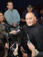 Tigers pitching coach Chris Bosio talks with reporters