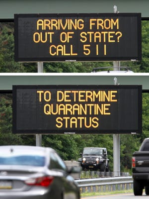 A quarantine reminder sign along Route 195 eastbound in Jackson Township shown Tuesday, June 30, 2020.