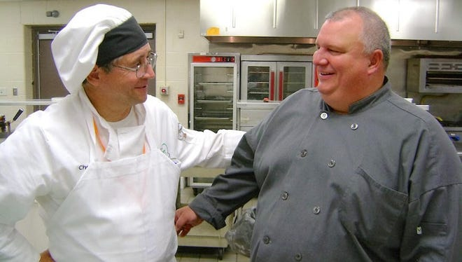 Chef Thomas Blike, the new culinary arts instructor at Mansfield Senior High School, talks with assistant Ed Golden.