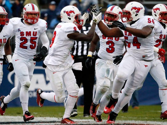 SMU defensive back Horace Richardson (9) celebrates