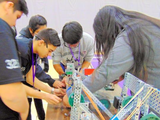 Students make last minute adjustments before entering