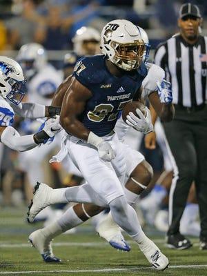Jonnu Smith of the Florida International Golden Panthers runs for a touchdown.