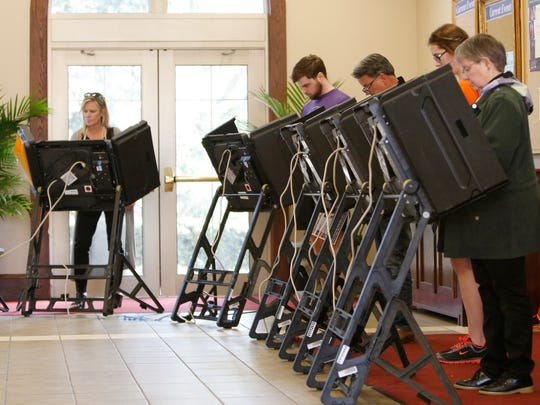 Voters cast their ballots at Immaculate Conception Church on Tuesday in Columbus.