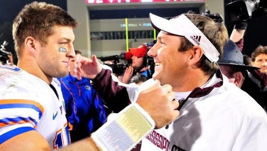 Quarterback Tim Tebow # 15 of the Florida Gators and Mississippi State Bulldogs head coach Dan Mullen greet one another following the game, at Davis Wade Stadium on  October 24, 2009 in Starkville, Mississippi  (Photo by Rick Dole/Getty Images)
