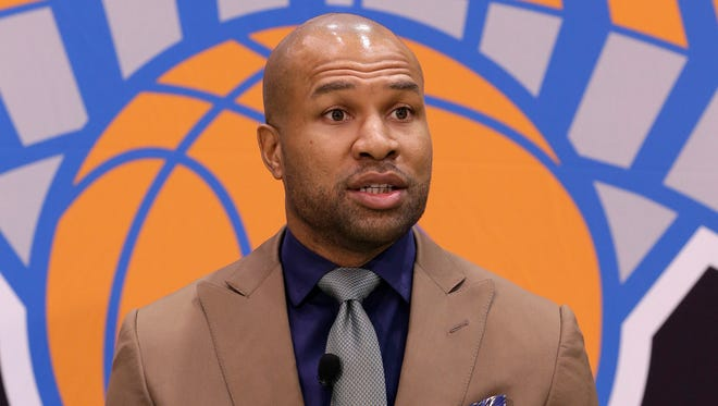 Derek Fisher participates in a news conference in Greenburgh Tuesday after he was named new coach of the Knicks.