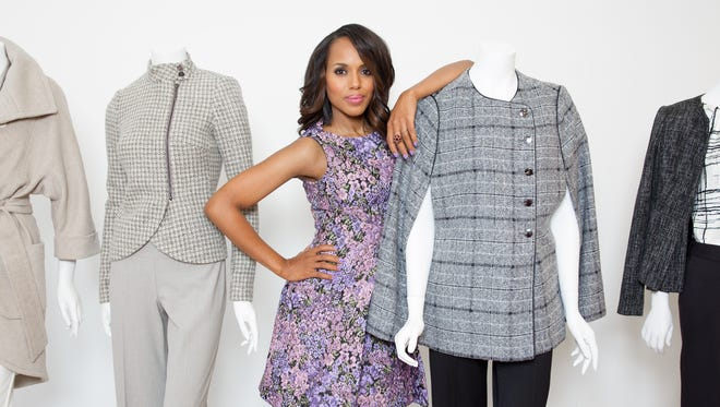Kerry Washington, poses with a selection of clothing designs inspired by her character, Olivia Pope, from the hit show 'Scandal' at the Limited fashion showroom in New York.  The Limited has launched the 'Scandal Collection' and Washington played a role in its inspiration as well as the design details.