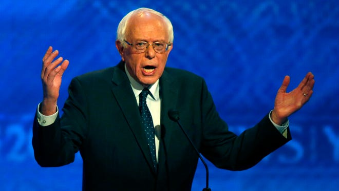 Bernie Sanders speaks during a Democratic presidential primary debate Saturday at Saint Anselm College in Manchester, N.H. Sanders' comment about the importance of a college education draw some sharp replies.