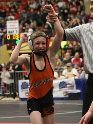 Jager Eisch of the Oconto Falls/Abrams youth wrestling program shows his emotion after capturing the 67-pound title at the Wisconsin Youth State Championships in Madison. Eisch has been wrestling since age 3.
