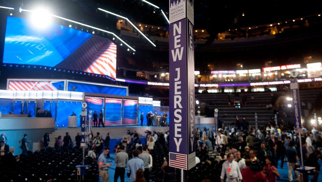 Workers put the final touches on the stage prior to the start of the Democratic National Convention at the Wells Fargo Center in Phiiladelphia on Monday morning.  07.25.16