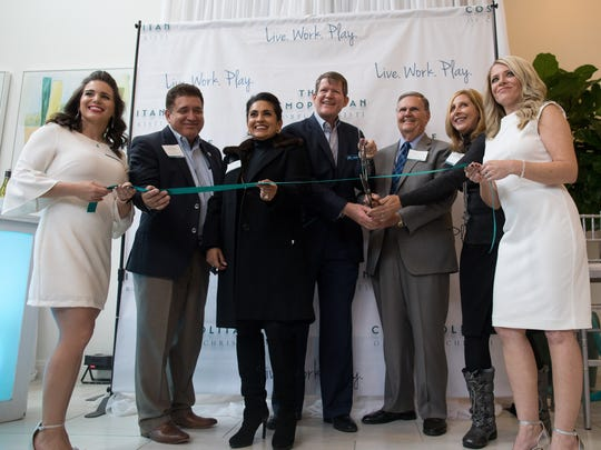 Members of the Corpus Christi City council take part in the Cosmopolitan ribbon cutting on Tuesday, Dec. 7, 2017.