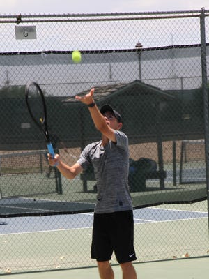 Riley Nesbit readies for a serve during the Saturday morning portion of the Cavern City Adult Tennis Tournament.