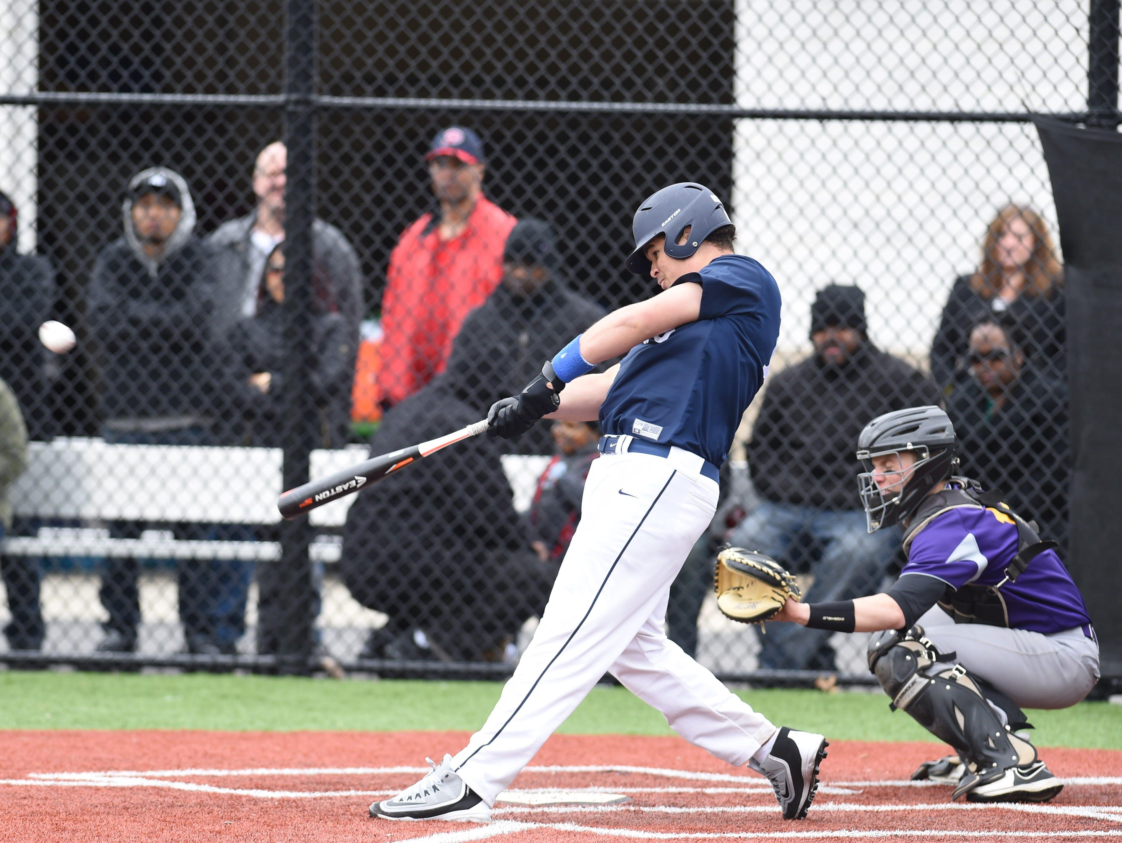 Poughkeepsie's Steven Disla hits during Saturday's game versus Rhinebeck at Poughkeepsie High School.