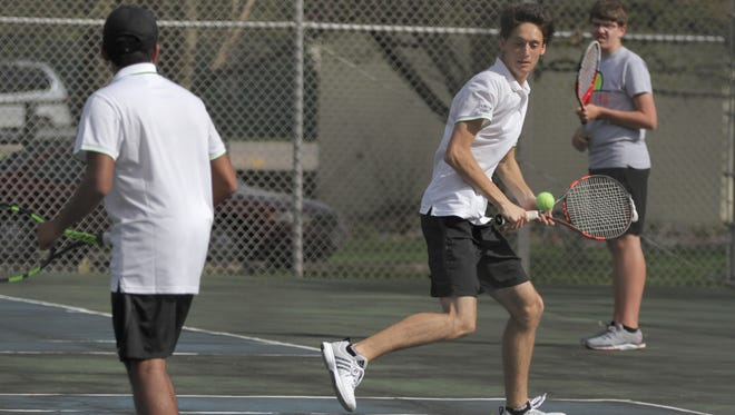 Lexington's Louis Bodjanac prepares for a backhand return as partner Agit Venkatakrishnan watches in Tuesday's Ohio Cardinal Conference showdown at Ashland. Lex's No. 2 doubles team rallied to win in three sets, giving the Minutemen a 3-2 victory at Brookside Park.