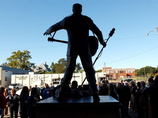An Elvis Presley sculpture, made by sculptor Eric Kaposta, was unveiled Friday morning in front of Municipal Auditorium, a day before a 50th Anniversary concert celebrating Elvis' first professional performance at the auditorium in 1954. The bronze sculpture is 7 1/2 feet tall and weighs approximately 1,000 pounds. 101504 (Jessica leigh/The Times)