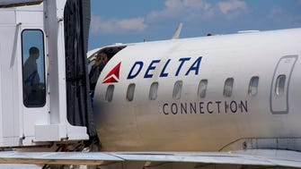 Passengers board a Delta jet at the Montgomery Regional Airport in Montgomery, Ala. on Wednesday August 12, 2015.
