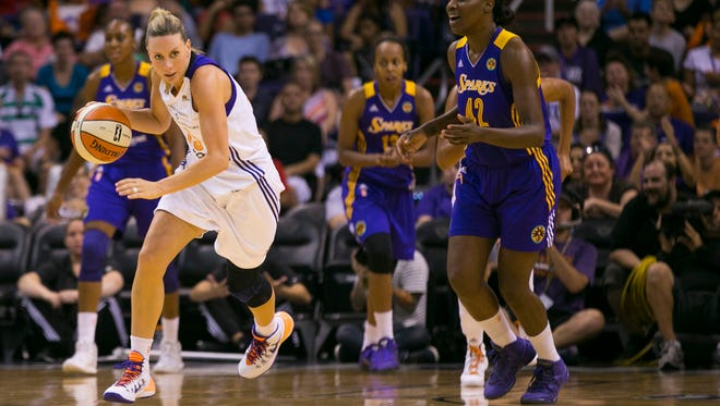 Mercury's Penny Taylor drives up court against the Sparks at US Airways Center in Phoenix, AZ on Saturday, August 16, 2014.