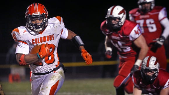 Columbus East running back Markell Jones had 154 yards on 33 carries and one touchdown against New Palestine in the Olympians' 30-28 loss to the Dragons in the 4A semistate football game at New Palestine on Friday, Nov. 21, 2014.