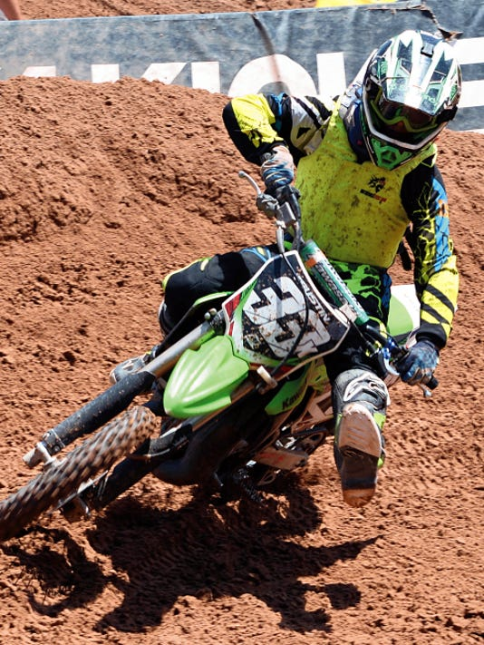 Matt Hollinshead — Current-Argus Carlsbad's Trustin Bratcher, 13, makes a sharp turn starting his next lap during a Carlsbad Arenacross amateur dirt bike race Saturday at the Eddy County Sheriff's Posse Arena.