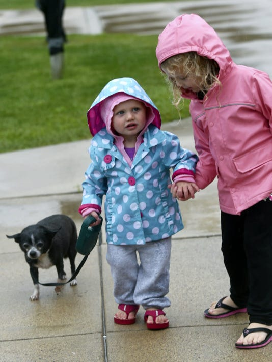 Kayla, 18 months, and her sister Brianna Hetrick, 4, Altoona, walk their dog Zoey after swimming at the Puppy Paddle Saturday at Chambersburg Municipal Pool.