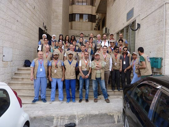 The Syrian American Medical Society's team of volunteers who worked March 7-13 at the Zaatari refugee camp in Jordan. The group of 32 included physicians, dentists, nurses, pharmacists and translators.
