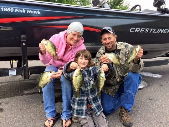 Paula, Jayden, and Jim Reed, with a few nice crappies.