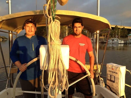 Kris Beall (left) and Ravin Pateel posed for a photo in March on a sailing trip. The two were some of the first participants in the LCATS summer sailing program.