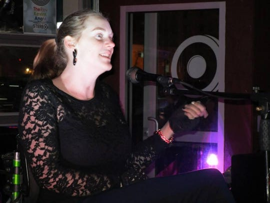 """Kelsey Warren performing """"My Body"""" during Women of the World Poetry Slam (WoWPS) 2015."""