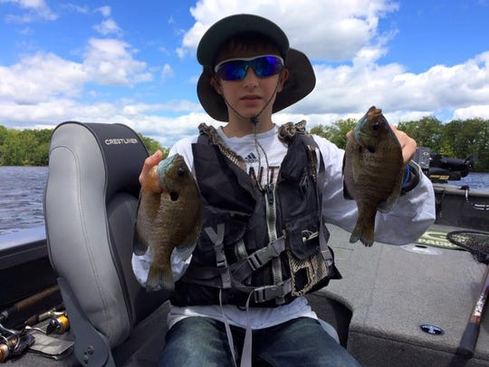Ray Smith and his grandson Max (pictured) with some nice bluegills in central Wisconsin