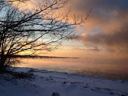 A winter fog is seen above the water on Lake Champlain.