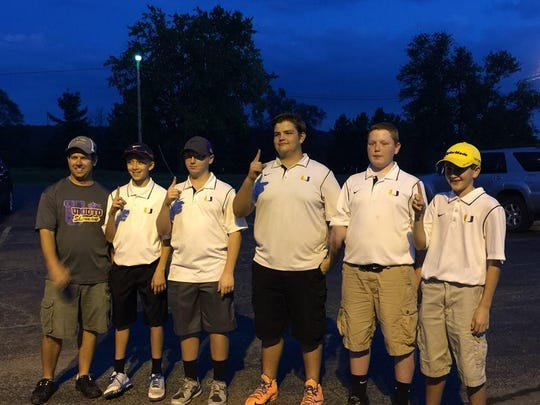 Pictured right-center JeRicho Rohn and his teammates pose for a photo after winning the 2015 SVC title for junior high golf for Unioto.