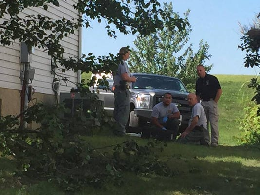Pennsylvania State Police investigators at the scene of Thursday night's standoff at 300 Shepherd Street in Jonestown, which ended with no injuries.