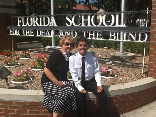 Linda DiGonzalez and her adopted son Javier celebrate Javier's middle school graduation from Florida School for the Deaf and the Blind in Jacksonville.