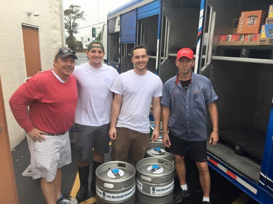 Pictured left to right: Jeff Hamer, owner FINS Ale House & Raw Bar and FINS Big Oyster Brewery; Red Killpack, assistant brewmaster; and Andrew Harton, head brewmaster